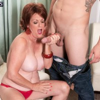 Older European dame Gabriella LaMay revealing humungous titties before giving oral sex