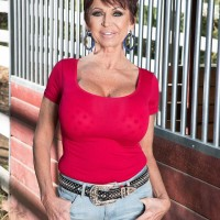 Over 60 doll Gina Milanos seduces a youthfull stud with her monster-sized tits in denim cut-offs
