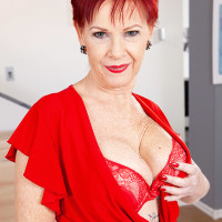 Over 60 redhead Caroline Hamsel plays with her boobies in crotchless underwear