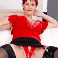 Over 60 redhead Caroline Hamsel plays with her tits while garmented in crotchless panties