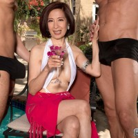 Over Sixty Asian MILF Kim Anh jerking off large cocks outdoors before MMF sex