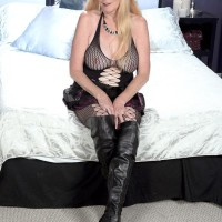 Over Sixty fair-haired MILF extracting large all natural funbags in ripped stockings and lengthy boots
