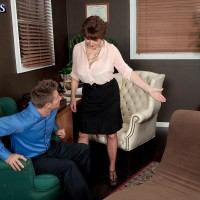 Over Sixty MILF Bea Cummins letting large all-natural titties fall loose in miniskirt and stilettos