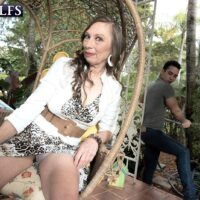 Over sixty MILF Mona gives  oral sex after seducing a junior dude in her backyard