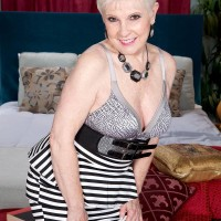 Over Sixty MILF XXX pornstar Jewel having giant boobs freed from sundress in hosiery and pumps