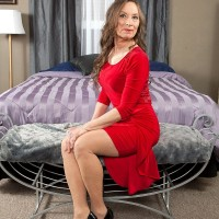 Pantyhose and high heel garbed granny Mona readying for sex with younger stud