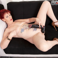 Red-haired granny Caroline Hamsel fellates a bevy of sex toys in in her skivvies