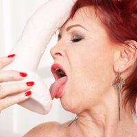 Redhead grannie Caroline Hamsel gobbles and gargles her bevy of sex toys in underwear