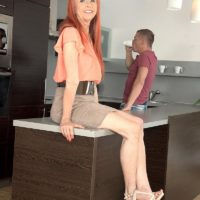 Redheaded grannie with superb gams and enormous natural knockers giving hj in kitchen