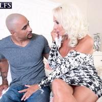 Seductive sixty plus MILF Madison Milstar tempts a younger ebony dude in a  dress