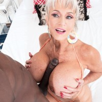 Sex grandmother Sally D'Angelo and her giant titties take on a BIG EBONY COCK outdoors in a Jacuzzi