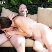 Seductive 60 plus female Cashmere is stripped bare naked before sexual intercourse on a patio