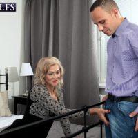 Seductive ash-blonde grandmother Beata tempts a junior man in a ebony mini-skirt and hosiery
