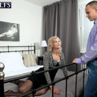 Jaw-dropping fair-haired grandmother Beata entices a young stud in a black mini-skirt and hosiery