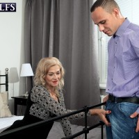 Sexy blonde granny Beata seduces a younger man in a black skirt and stockings
