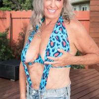 Sexy Sixty plus MILF Silva Foxx entices a junior man by showcasing her boobies in a denim micro-skirt