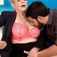 Short haired granny Lin Boyde letting out monster-sized juggs before delivering hand job and FELLATIO