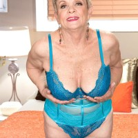 Short haired Sixty plus MILF Lin Boyde unleashing humungous knockers from lingerie in hose