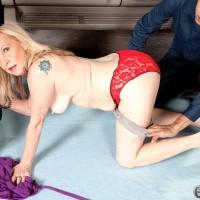 Sixty plus blond grandmother Miranda Torri uncovering massive mature hooters before MMF Threeway