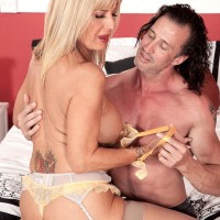 Stocking and lingerie clad experienced pornographic starlet Phoenix Skye unsheathing immense hooters and giving massage