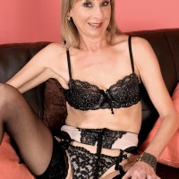 Stocking and lingerie clad granny Patsy crossing and uncrossing legs in stilettos