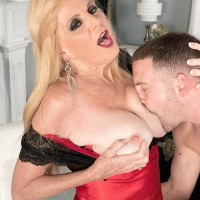 Stocking and lingerie garmented Sixty plus fair-haired MILF Charlie releasing huge titties for nipple play