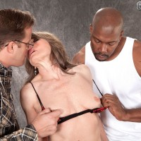 Stocking and lingerie wearing MILF over 60 Donna Davidson having multiracial MMF