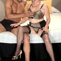 Stocking garmented grannie Bea Cummins giving BBC hj in high heeled shoes and girdle