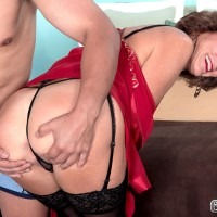 Stocking, garter and lingerie garmented Sixty plus MILF Sydni Lane extracting booty for sex acts