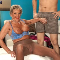 Stockings attired Seventy plus MILF Sandra Ann letting out big boobs before sex with younger stud