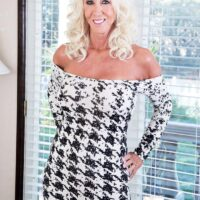 Sumptuous 60 plus MILF Madison Milstar entices a junior black stud in a tight fitting sundress