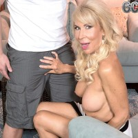 Tall over 60 blond MILF Erica Lauren pulling out big aged boobs and shaven cunt