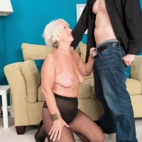 Tights and miniskirt garmented grannie Jeannie Lou sucking off massive junk on knees