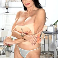 Top aged XXX adult star Rita Daniels uncovers her massive boobies and flashes her underwear as well