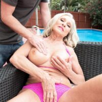 Wonderful 60 plus doll Katia has her immense boobies pawed at by a junior boy on patio